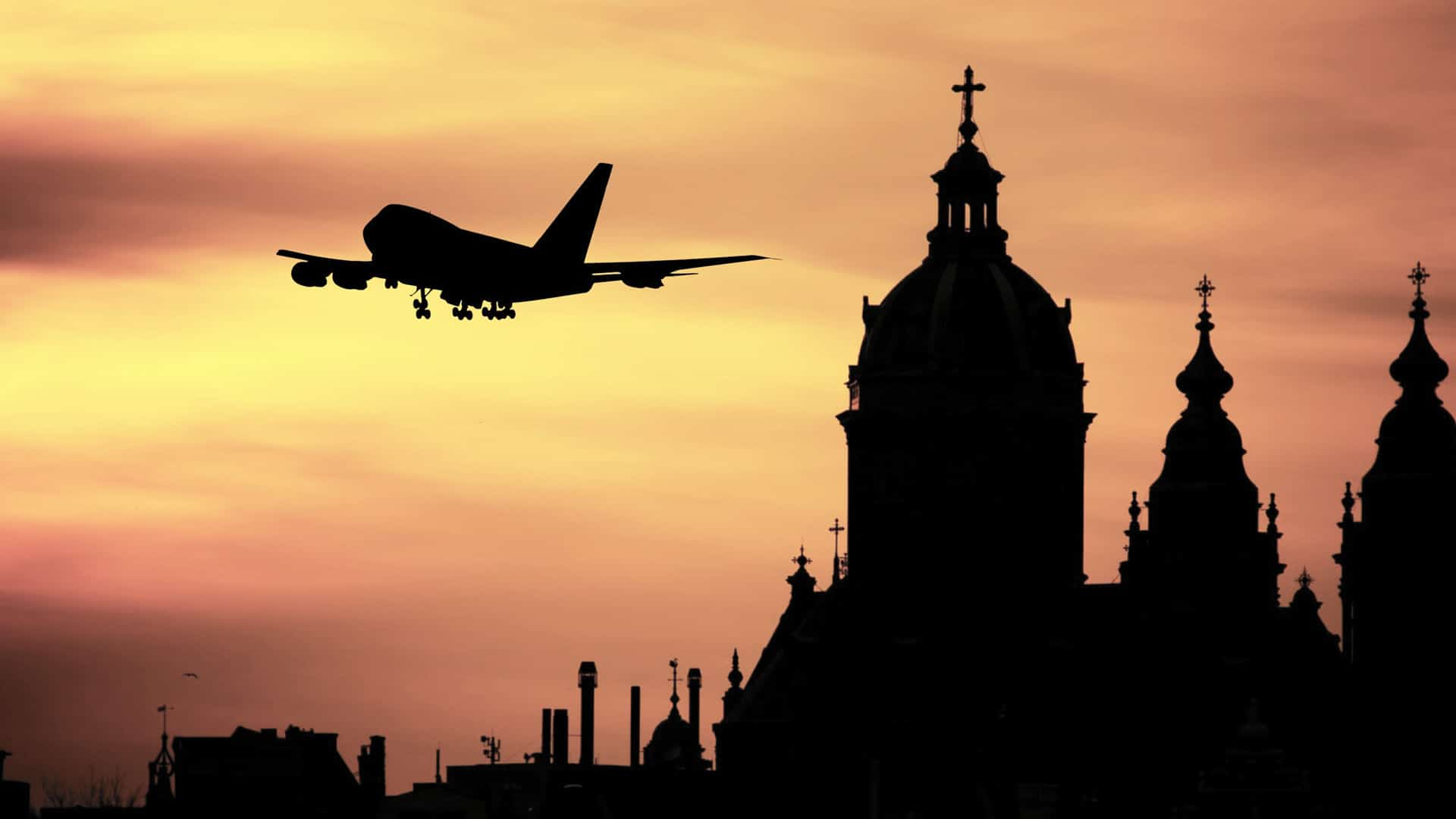 Plane and Building Silhouette